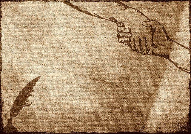 podání ruky na papíře
